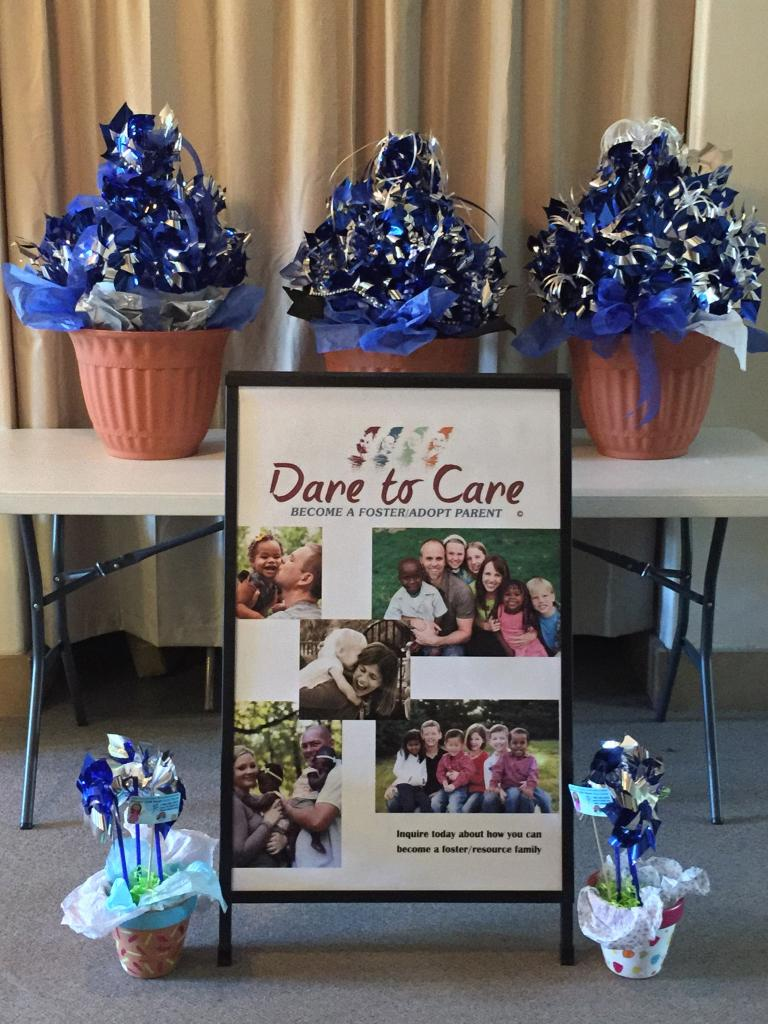 blue and white pin wheels for foster care
